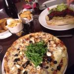 Chicken, goat's cheese and rocket pizza with French fries.   Steak and cheese sandwich with ch
