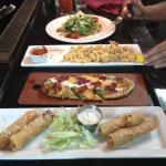DELICIOUS!!!  Front to back: Chicken spring rolls, flatbread, calamari, beef carpaccio