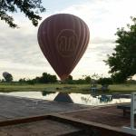 Hot air balloon landed near the swimming pool area