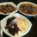 Front: Ais kacang (dessert);  Upper left: Rojak with prawn sauce (snack);  Upper right: Asam L