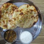 Paneer and aloo kulcha with raitha and channa.