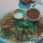 Four grilled Fish taco with rice and beans.  On small corn tortillas.