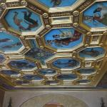 The ballroom ceiling features paintings of dances from around the globe