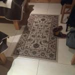 Poor floor covering, with tiles that failed to insulate room from either cold or noise