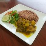 Curried Goat served with a Tossed Salad and Rice & Peas