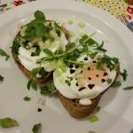 Poached eggs on toast with chilli, spring onion and coriander.
