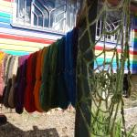 Some colourful skeins and a spider web hung from the rainbow community centre.