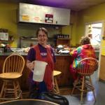 Karen serves coffee at Trading Post