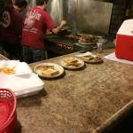 Open pit grill inside restaurant