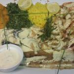 Sea food platter for 2 dripping with lemon butter sauce.