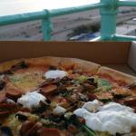 Amazing PizzaFace vegan pizza with Brighton sunset