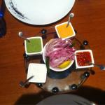 mix of dressings for kebabs: mint, tomato, yogurt, peanut, onion, Green peppers & lemon
