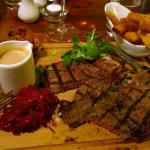T bone steak with a jug of deliciously creamy pepper sauce