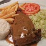10oz steak with green peppercorn sauce
