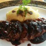 Duck with blueberry sauce accompanied with truffle mash potato