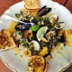 Clams and mussels in a deliciously made garlic, cilantro and onions served with a side of garlic