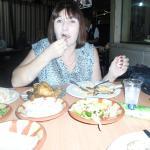 The sister enjoying her chicken!