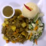 curried goat along with garlic mash potatoes