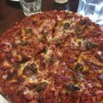 $22 for a large American pizza. Generous toppings made it a little soggy.