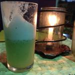 Fresh pineapple juice with mint by candlelight