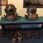 My diving helmet and shoes on the left; the museum's helmet and shoes on the right.