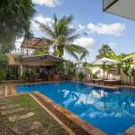 Saltwater pool with adjoining bar and open-kitchen restaurant