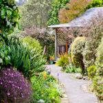 Garden paths lead from cottage to cottage