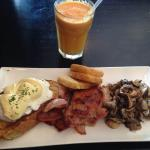 Cucina eggs Benedict with side of hashbrowns and a combo juice- YUM