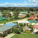 Self contained heritagestyled cottages and tennis courts