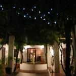 Fairy lights at night over entrance to courtyard