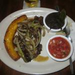 Steak with black beans, pico de gallo and fried plantain