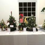 "From Left: ""Spirits"" Tree, Book Lover's Tree, Dog Lover's Tree, Decorator's Dazzle Tree, ""Statem"