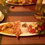 Curried grouper with basmati rice, and a salad made from apples, dragon fruit, red onion, cucumb