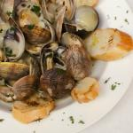 Steamed Clams in white wine sauce served with baguettes