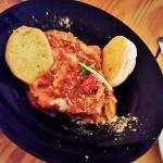 House-made Lasagna with sausage and beef & garlic buttered roll halves.