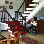 The stairway leading to rooms upstairs