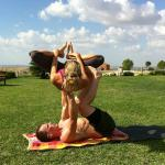 Doing acro yoga with my wife on the grounds in front of the main building.