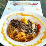 SESAME SEED CRUSTED HOG SNAPPER OVER ANGEL HAIR PASTA WITH A CURRY LEMON GRASS SAUCE