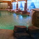Lodge pool, hot tub is to the right of the waterfall.