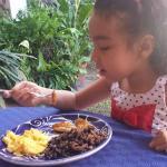 Eva enjoying the daily breakfast
