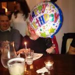 kelly bringing me a birthday cake