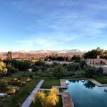 Sunbath with a view of snowcapped Atlas mountains