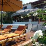 Enjoy our sundeck, open air palapa dining and infinity pool