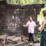 Sopanha explaining some of the stone carvings at Banteay Chmer, one of the most remote and impre