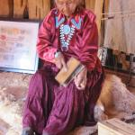 Elderly Navajo lady with a yarn spinning demonstration.