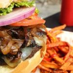Burger with sauteed onions, swiss, and mushrooms