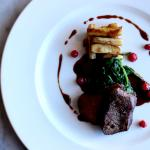 Venison Loin with roasted parsnip, creamed spinach, red currants