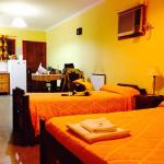 A double room with full kitchen, air-con, heat, hot water, TV, fridge, table, etc.