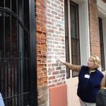 Linda pointing out slave-made bricks