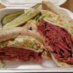 New York Style Pastrami Sandwich,  with Coleslaw,  Swiss Cheese with a side of Potato Salad and